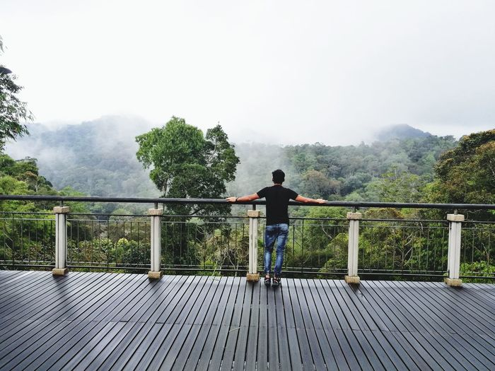 Sky Moutains Outdoors Railing People Tree One Person Adult Full Length Day Fog Water Bridge - Man Made Structure Standing Adults Only Men Spraying One Man Only Nature Only Men