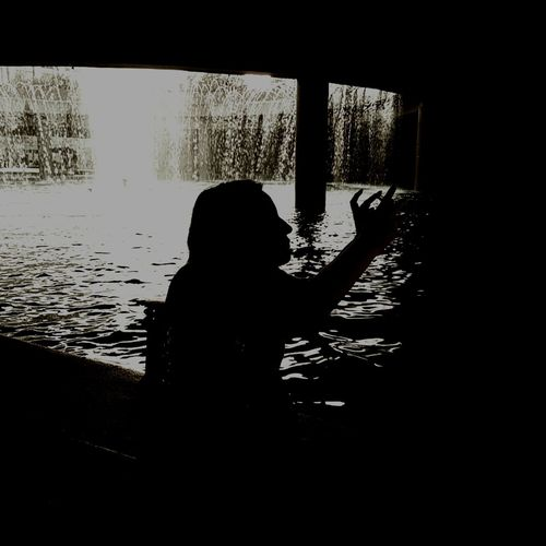 Strange photo of my wife at Marco Plaza Riverwalk in Monterrey Mexico Fountain Monterrey Monterrey Mexico Monterreymexico Mexico Odd Strange Unusual My Wife My Love Monochromatic Water Silhouette Shadow Pixelated Outline Calm Spraying Energetic