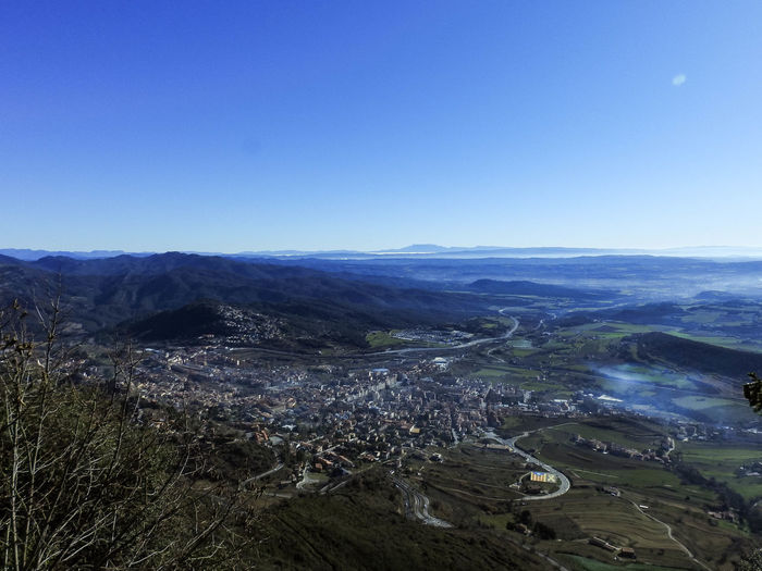 High angle view of landscape against clear blue sky