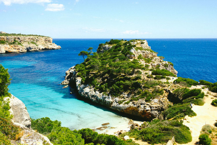 #beach #bluewater #caladesmor #majorca #mallorca #mediterranean #sun Bay Beach Beauty In Nature Blue Day Idyllic Nature Outdoors Rocky Coastline Sea Sky Tranquil Scene Tranquility Turquoise Colored Water