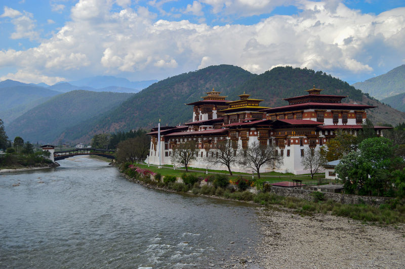 Punakha Dzong My Best Photo Bhutan Nature Nature_collection Nature Photography Naturelovers Landscape Landscape_Collection Water River Palace Architecture Nikon Clouds And Sky Cloud - Sky Mountain Mountain Range Mountains Cold Temperature Heritage Beauty In Nature Building Exterior Sky Sky And Clouds Bridge - Man Made Structure Bridge Beautiful Beautiful Nature No People Scenery Scenics - Nature Clear Sky Blue Blue Sky Calm Waterfront Built Structure Outdoors Tree Religion Building