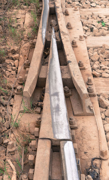 track changing point near railway station Arrow Direction Forward Intersection Iron Knot Leading Metal Pin Point Rail Railing Shadow Sharp Sleeper Steel Steps Stone Straight Track Train Turn Way Wood Wooden