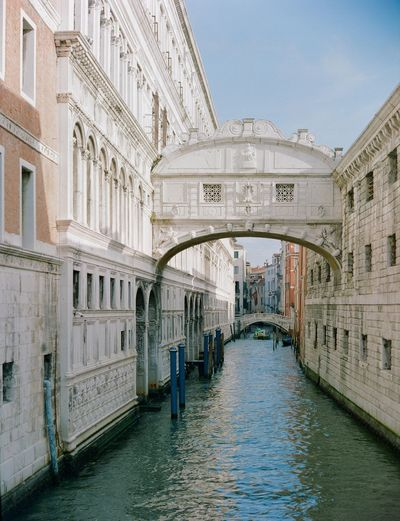 Arch bridge over canal in city