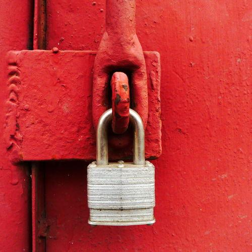 Close-Up Of Padlock On Red Door