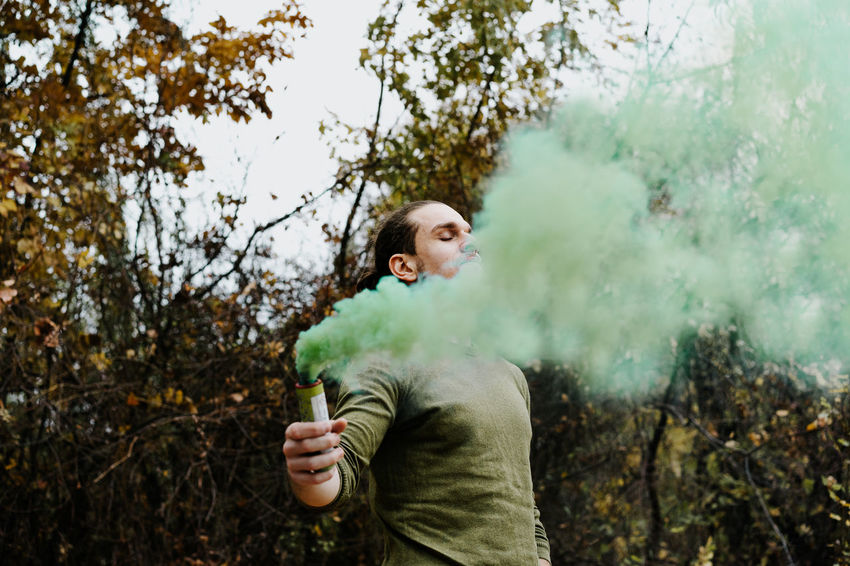 Autumn Colors Colours Portrait Eyes Closed  Smoke Smoke - Physical Structure Smoke Bomb Green Color Green Young Men Tree Forest Holding Men Human Hand Firework - Man Made Object Entertainment Sparks Firework Display Incense Autumn Mood 50 Ways Of Seeing: Gratitude