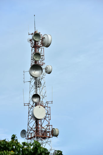 Low angle view of communications tower against sky