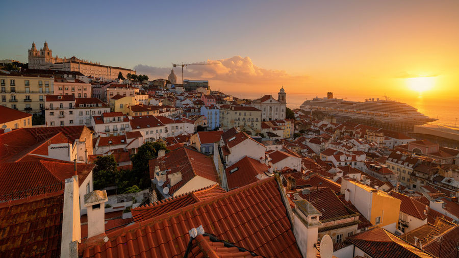 have been travelling around recently and hope to visit more places soon! this is a great location to watch the sunrise in Lisbon; i was so lucky yesterday morning and captured this wonderful moment Landscape Architecture Sunshine City Cityscape Urban Skyline Sunset Skyscraper Aerial View Sky Architecture Housing Settlement TOWNSCAPE Roof Tiled Roof  Roof Tile Old Town Townhouse Human Settlement Settlement Rooftop Crowded Residential District Residential Structure Town