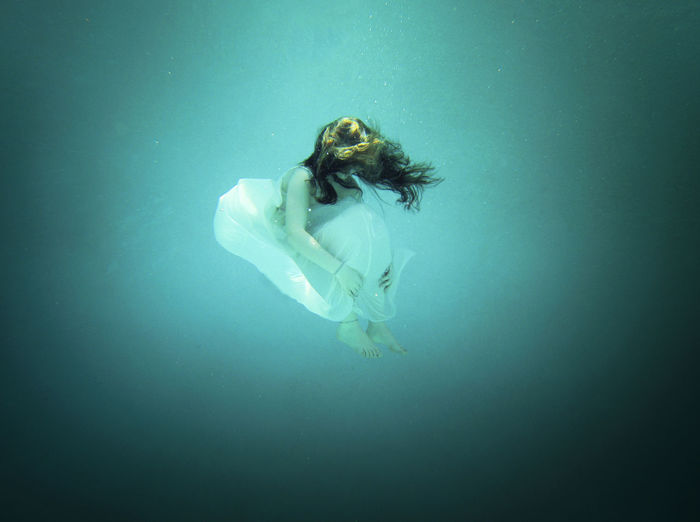 High Angle View Of Beautiful Woman Wearing Dress Floating Undersea