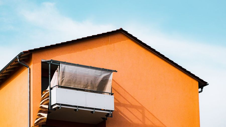 Urban Perspectives Architectural Detail Balcony Street Photography Apartment Built Structure Building Exterior Architecture Sky Low Angle View No People Building Orange Color Cloud - Sky Day House Outdoors Residential District Roof High Section Sunlight Wall - Building Feature The Devil's In The Detail The Architect - 2019 EyeEm Awards My Best Photo