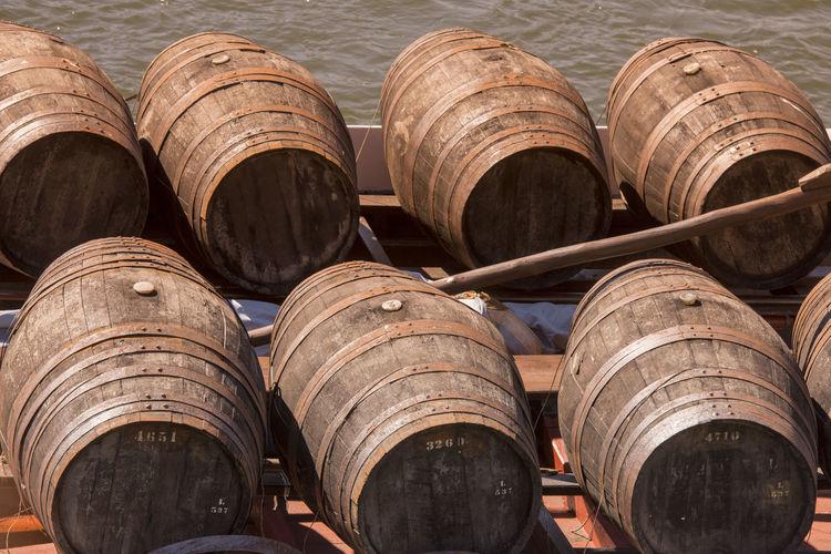 Barrels in boat on lake