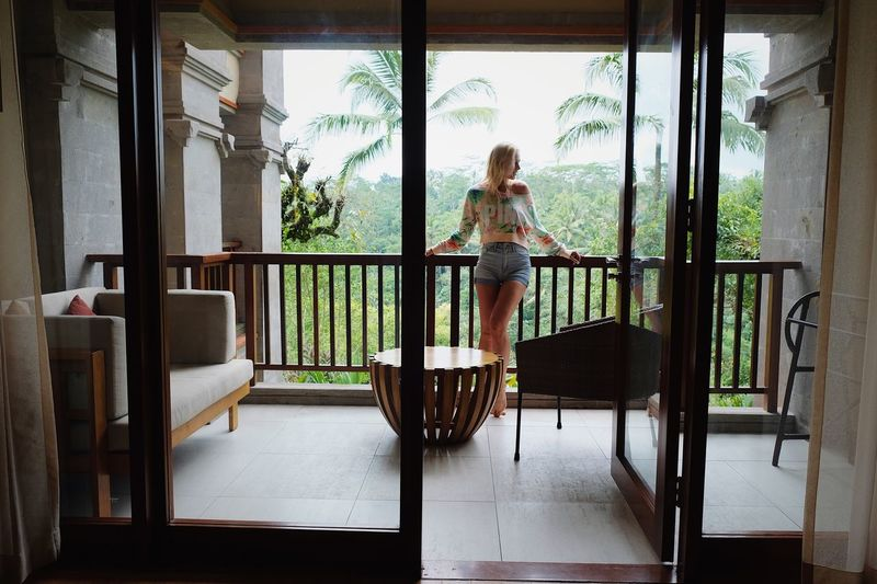 Full Length One Person Women Lifestyles Real People Day Leisure Activity Architecture Looking Indoors  Females Blond Hair Window Hair Adult Seat Child Hairstyle