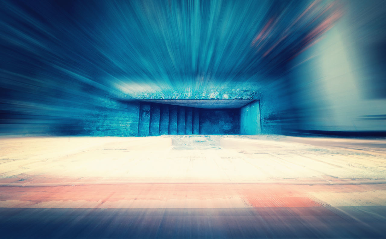 DIGITAL COMPOSITE IMAGE OF EMPTY TUNNEL IN CITY