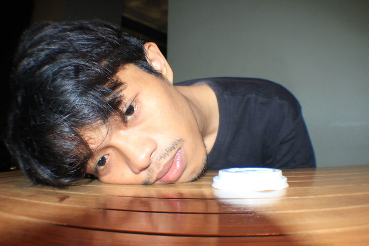 Sad man on table at home