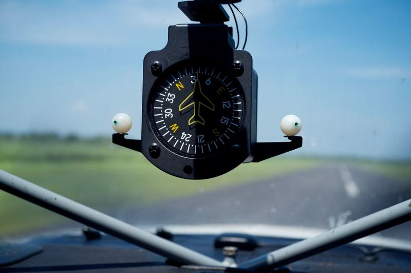 Close-up of compass gauge in airplane