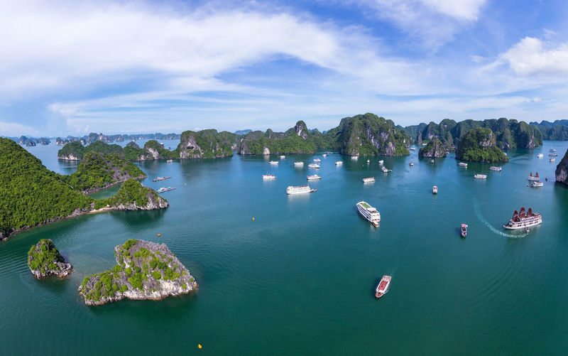 Halong Bay Vietnam panorama. from above Island Drone  Drone Shot Ha Long Hà Nội Panorama Tourist Travel UNESCO World Heritage Site Vietnam Above Beauty In Nature Boat Famous Place Fly Camera Ha Long Bay Ha Long Bay Cruise Ha Long Pearl High Angle View Hight Quality Landscape Quảng Ninh Ships Tourism View From Above