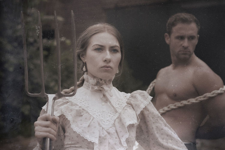 Rapunzel Barn Boundary Braid Braided Braided Hair Braids Couple Couple Portrait Long Hair Muck-rake Muckrakers Oldfashioned Oldschool Pitchfork Portrait The Portraitist - 2017 EyeEm Awards Tied Togetherness Two People Village People Young Adult