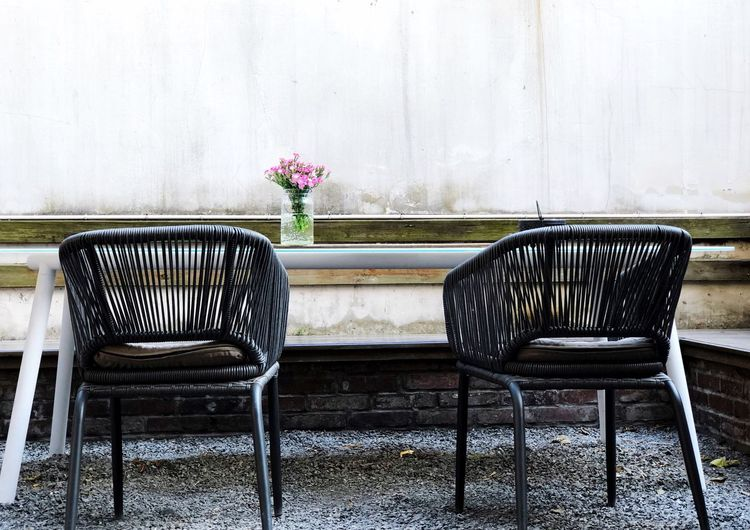 Seat Flower Flowering Plant Chair Plant No People Table Nature Empty Wall - Building Feature Furniture Built Structure Day Absence Outdoors Vase Architecture Arrangement Freshness Wall