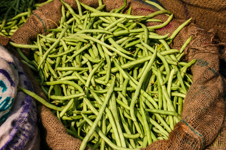 Close-Up Of Green Beans For Sale In Sack