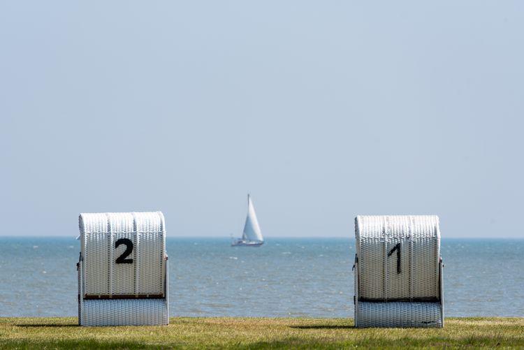 Hooded Beach Chairs Against Sea