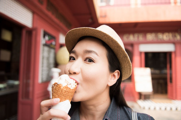 Portrait Of Mid Adult Woman Eating Ice Cream