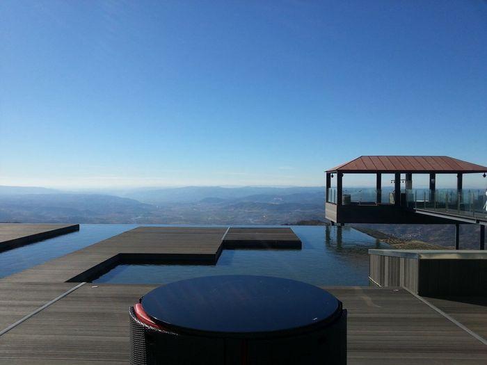 Infinity pool at resort against blue sky