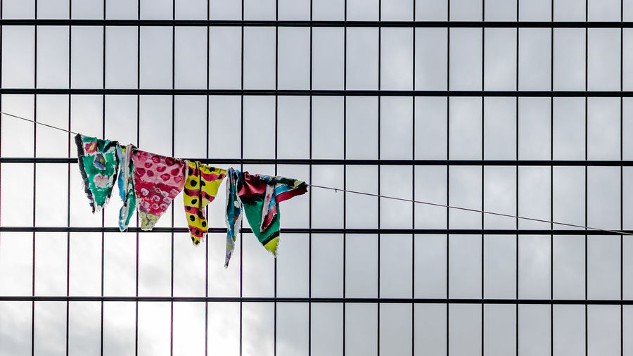 Clothes Hanging On Rope Against Modern Building