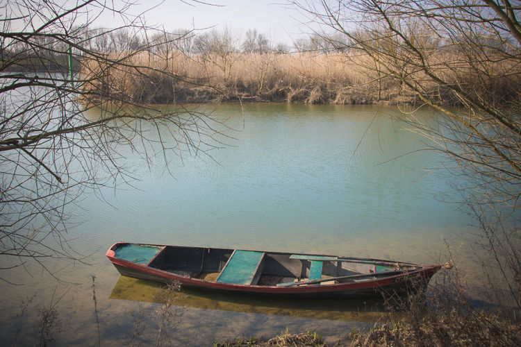 Saône River Riverside Water Nautical Vessel Mode Of Transportation Transportation Lake Tranquility Reflection No People Nature Tree Tranquil Scene Day Moored Plant Outdoors Beauty In Nature Abandoned Non-urban Scene Bare Tree Rowboat Sinking Sailboat Blue