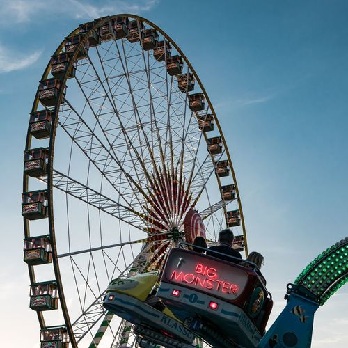 Big Monster EyeEm Selects City Ferris Wheel Amusement Park Ride Arts Culture And Entertainment Amusement Park Sky Architecture Built Structure Big Wheel Traveling Carnival