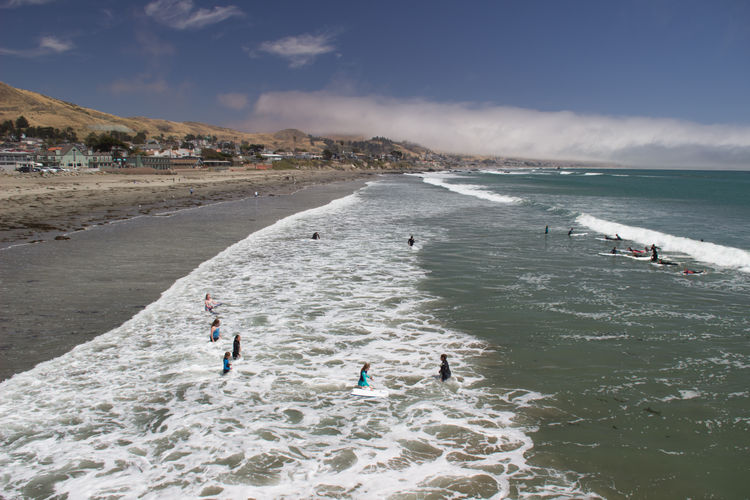 Beach California Cayucos Coast Coastline Fog Foggy Leisure Activity Lifestyles Mountain Outdoors Pacific Ocean People Shore Sky Surfing Swimming