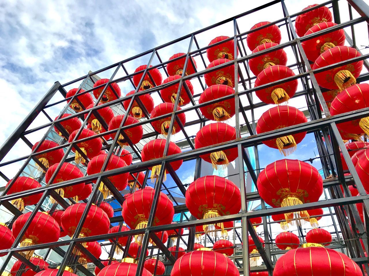 red, day, outdoors, cloud - sky, low angle view, sky, in a row, no people, hanging, large group of objects, close-up