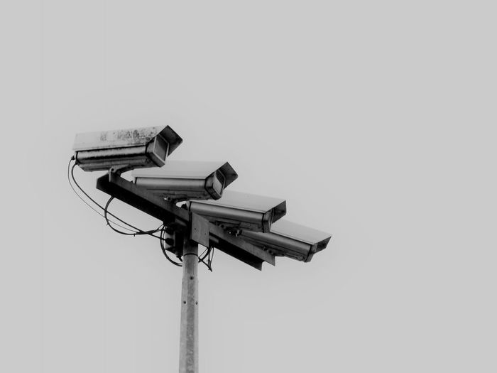 Surveillance Cameras Against Sky