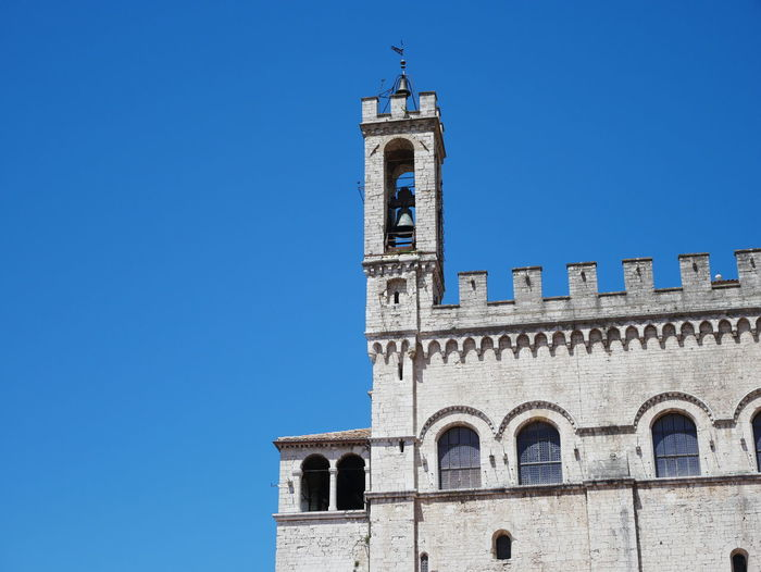 Low angle view of historic building against clear blue sky