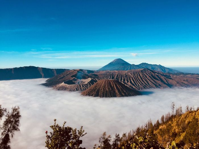 Scenery of Bromo mountain with white mist. Amazing Scenery Amazing View Bromo Mountain Indonesia Travel Photography Traveling Bromo-tengger-semeru National Park Bromo Mountain EyeEm Selects Scenics - Nature Mountain Sky Beauty In Nature Tranquil Scene Tranquility Environment Travel Destinations Land Cloud - Sky Volcano Plant Non-urban Scene Blue Landscape Tree No People Nature Geology Travel EyeEmNewHere