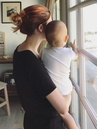 Mother and son House Interiors  Home Looking Holding Natural Light Window Light Mother And Son Togetherness Toddler  Motherhood Two People Baby Young Child Real People Indoors  Women Family Lifestyles Window Home Interior Parent Mother Childhood Love Positive Emotion Adult
