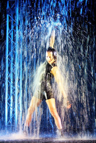 Art Artists Blue Event Exhibition Green Green Color Illuminated Motion Blur Overnight Success Performance Red Show Theatre Water Waterfall Waterfront Waterwall Performance Young Adult Young Woman Who What Where