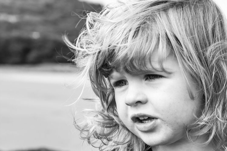 Childhood Blond Hair Headshot Portrait Girls Child Elementary Age One Person Real People Outdoors Looking At Camera Human Face Smiling Children Only Happiness Day Close-up People Black And White Portrait Windy Day The Week On EyeEm