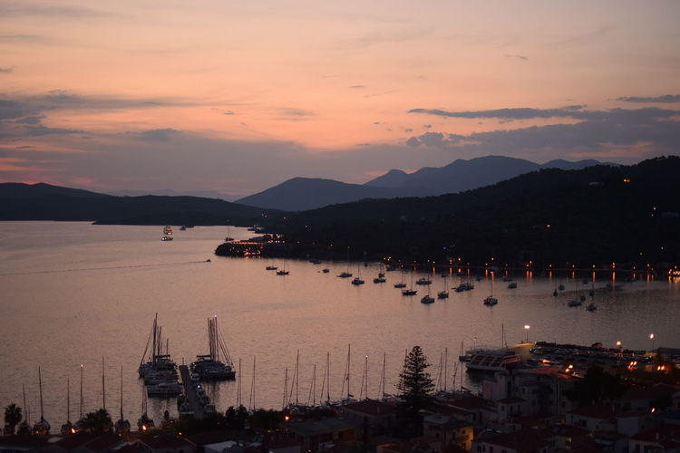 Poros island at dusk Architecture Bay Beauty In Nature Cloud - Sky Dusk Greece High Angle View Island Mountain Mountain Range Nature Nautical Vessel No People Orange Color Outdoors Port Sailboat Sailing Scenics - Nature Sea Sky Sunset Tourism Wallpaper Water