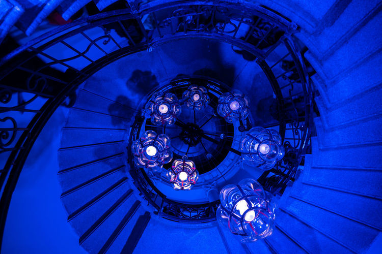 Blue Stairs Illuminated Architecture Blue Low Angle View Lighting Equipment Indoors  Staircase Chandelier No People Directly Below Spiral Staircase Spiral Ceiling Light Design