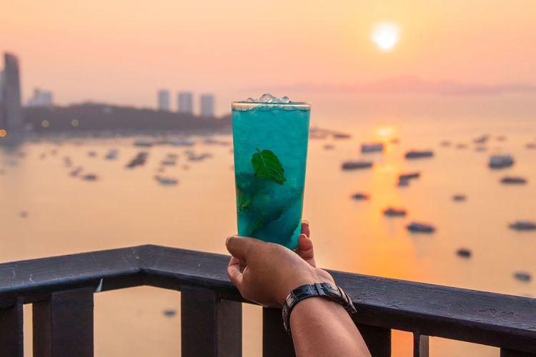 A blue mojito cocktail at a rooftop bar in thailand southeast asia