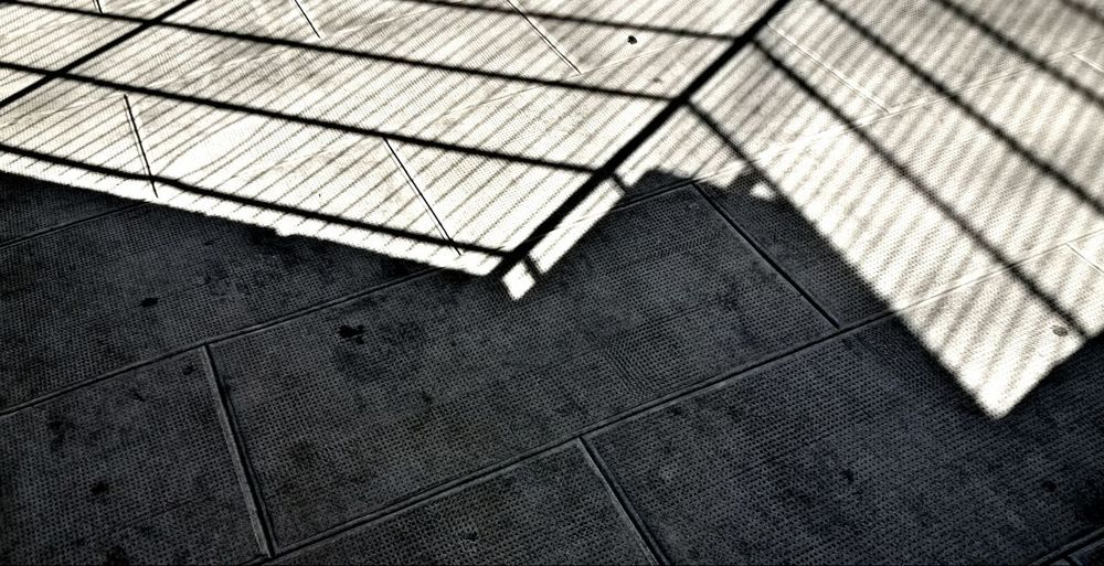 Streetphotography Light And Shadow Sidewalk Caged