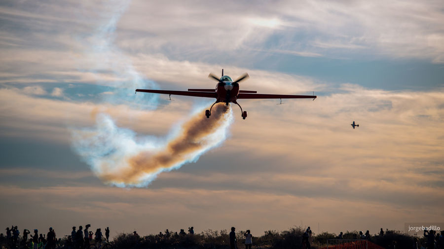 Aerobatics Aerospace Industry Air Vehicle Airplane Airshow Cloud - Sky Flying Low Angle View Mid-air Mode Of Transportation Motion Nature No People on the move Outdoors Plane Sky Smoke - Physical Structure Speed Sunset Transportation Travel Vapor Trail
