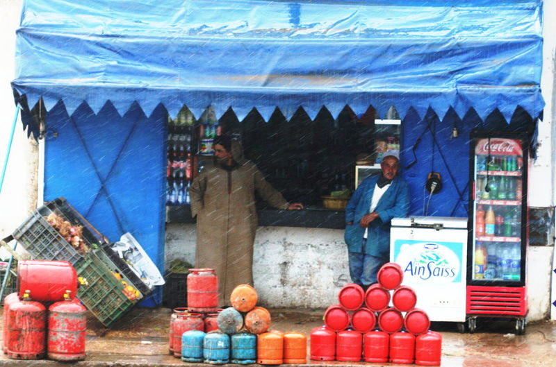 2011 Day Food Gaz Market Morocco On The Road Outdoors Raining Real People Shop Two Persons Water