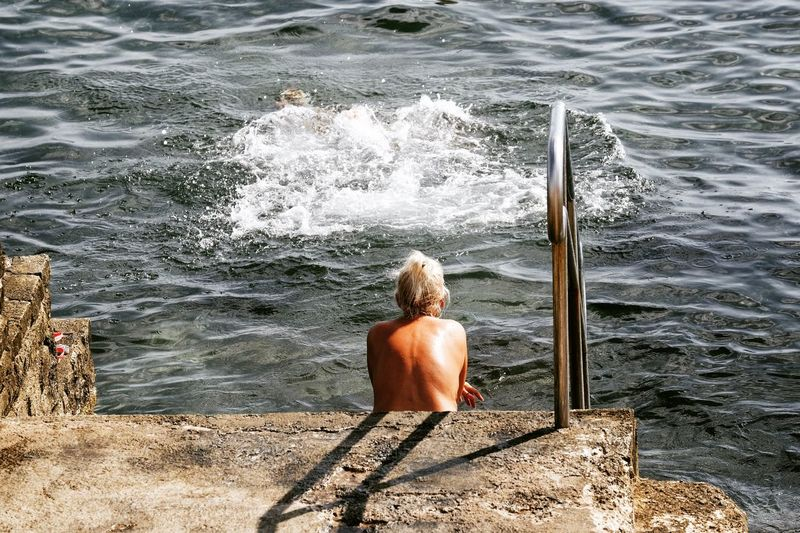Adult Adults Only Archival Beauty In Nature Day Human Back Nature One Person One Woman Only Only Women Outdoors People Rear View Sea Sitting Water Wave The Street Photographer - 2017 EyeEm Awards International Women's Day 2019