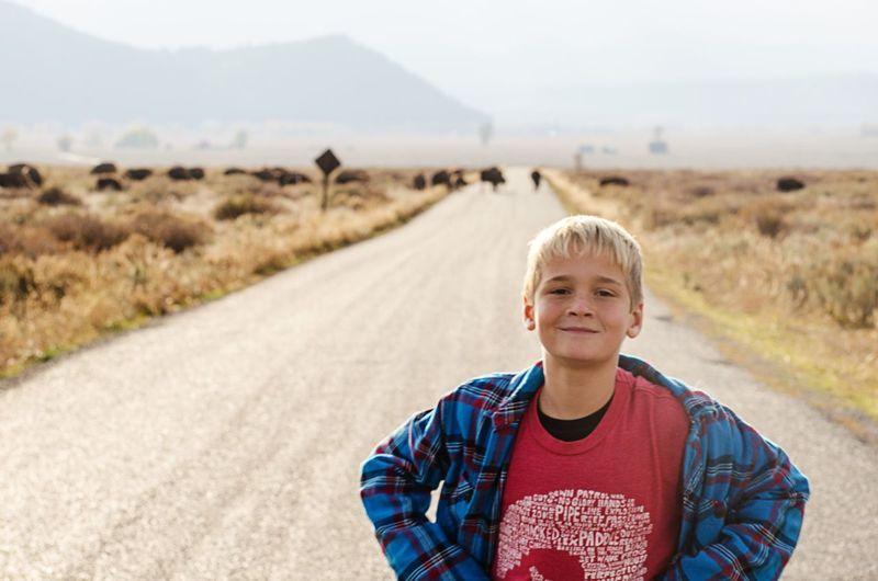 Buffalo Crossing kid Kid Smile West Explore Kids Travel