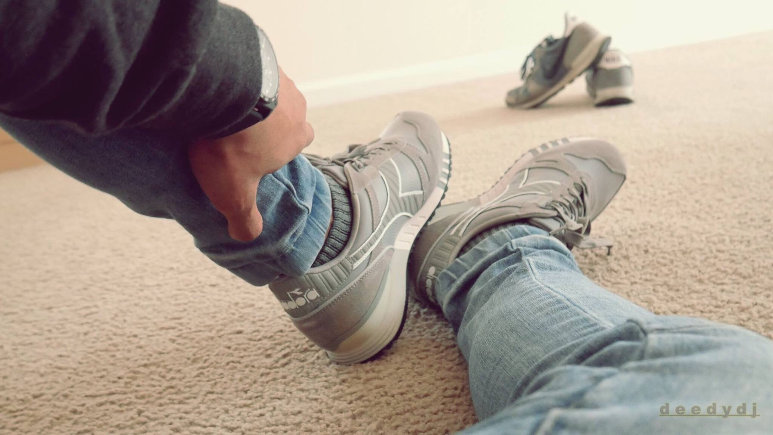 shoe, human leg, low section, human body part, jeans, human foot, casual clothing, lifestyles, human limb, limb, one person, rolled up pants, leisure activity, close-up, men, sock, canvas shoe, women, day, people, flip-flop, adult, indoors, adults only