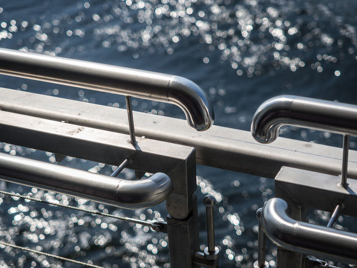 Close-Up Of Metal Railing In Front Of Water