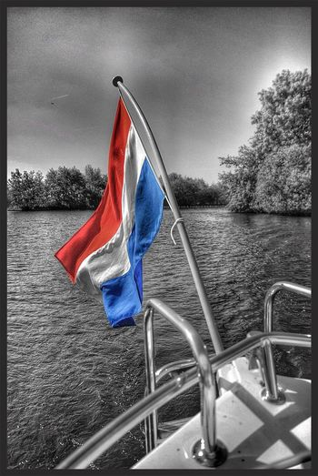 Low angle view of flag in water