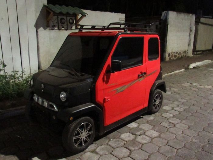 Eco friendly Electric Car Car Land Vehicle Transportation Red Stationary Outdoors No People Architecture Built Structure Day Building Exterior