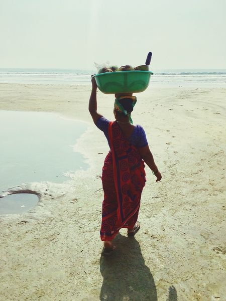 Sea Full Length Beach Real People Rear View Carrying On Head India Goa Ashvem Beach Indian Culture  Business Unrecognizable Person