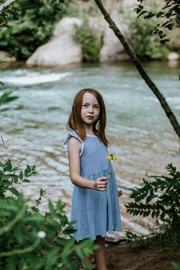 Portrait of teenage girl standing in water